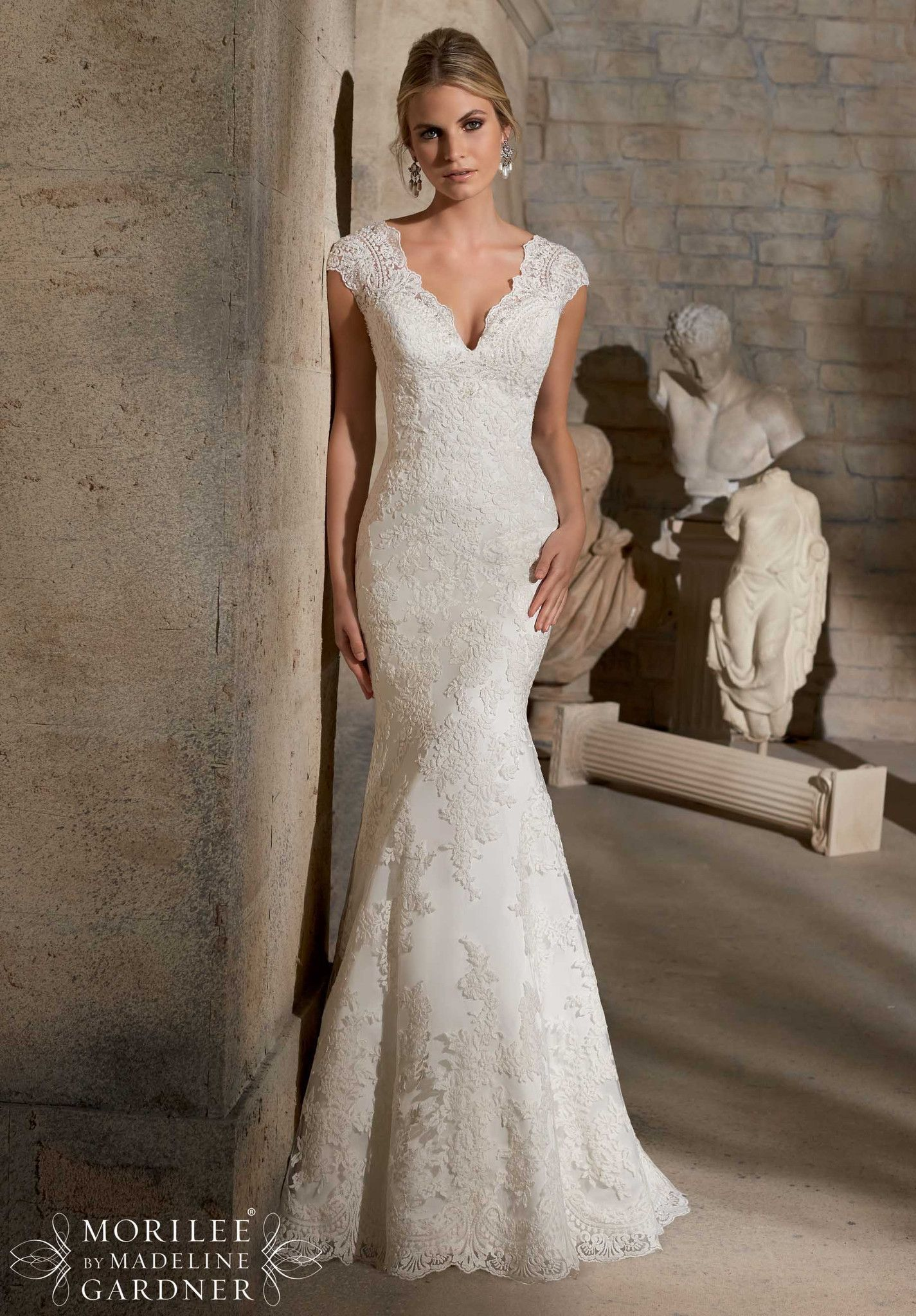 Mori lee embroidered appliqués on net with crystal beading and