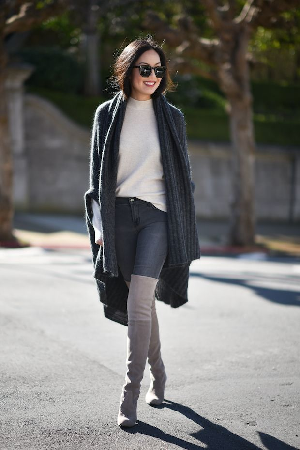 2b9670454ad Ann Taylor is wearing over the knee boots with classic skinny jeans and a  long cable knit cardigan