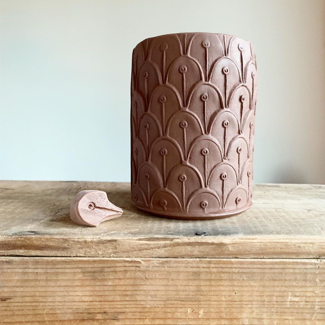 This Little Stamp Is A Simple One I Love Watching The Pattern Emerge As It Is Repeated Reminiscent Of Peacock Feat Coil Pottery Beginner Pottery Clay Pottery