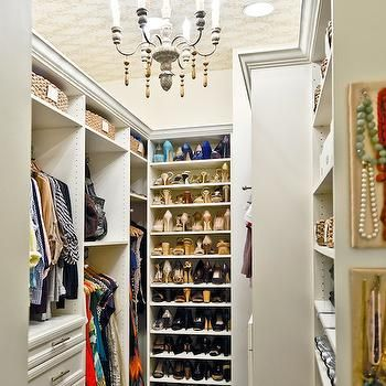 Closet with wallpapered ceiling laundry rooms pinterest beautiful closet features wallpapered ceiling punctuated with candle chandelier over wall to wall jute carpeting aloadofball Images
