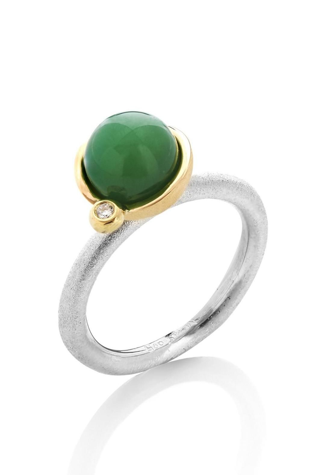 This ring is a stunning combination of silver, 18k gold and the radiant green chrysoprase. On the side, we put a small diamond as a lovely final detail. You can wear this ring with other stacking rings or with a plain band or maybe just alone! The chrysoprase is 9 mm round and it is a 0,02 ct tw/vvs diamond.   Stacking Ring with Chrysopras by Milas Jewellery. Accessories - Jewelry - Rings Copenhagen, Denmark