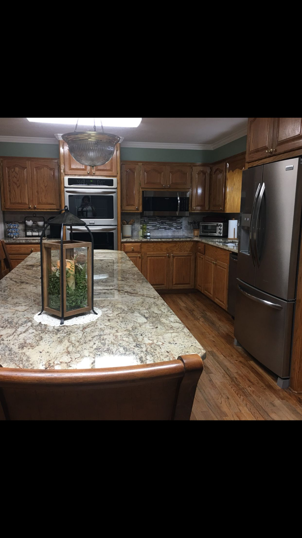 Typhoon Bordeaux with oak cabinets. | Kitchen, Home decor