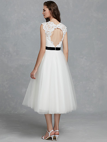 9b111545312 This is the perfect wedding dress for the vintage bride! It has an adorable  retro