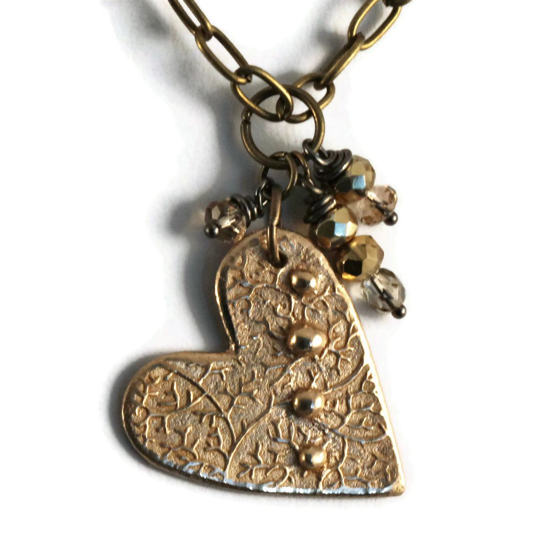 Love this delicate heart necklace handcrafted with goldie bronze
