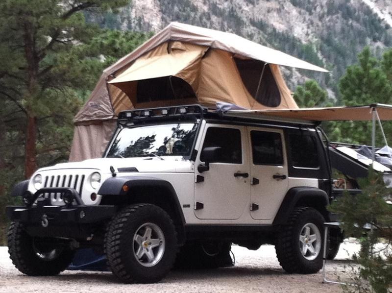 I M Liking This Whole Top Of Suv Tent Deal One For The Xterra Jeep Wrangler Camping Jeep Camping Jeep Tent