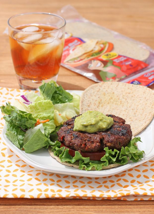 These Mexi-Burgers with Guacamole are the perfect lightened-up, man-friendly meal for Father's Day. Fire up the grill with something hearty, healthy & tasty - each burger is just 313 calories or 8 Weight Watchers points! www.emilybites.com