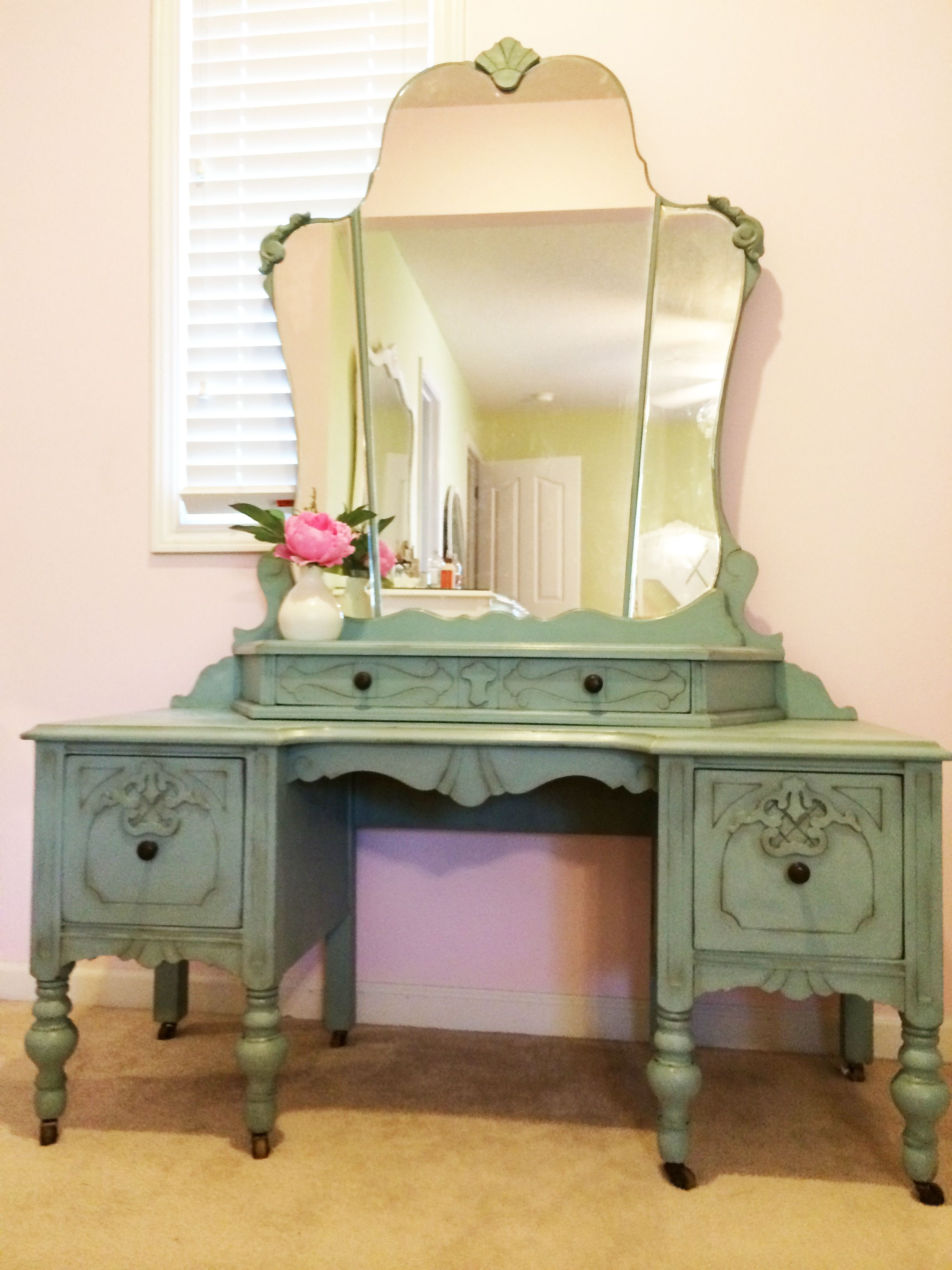 An antique vanity painted with Annie Sloan chalk paint, lightly distressed.