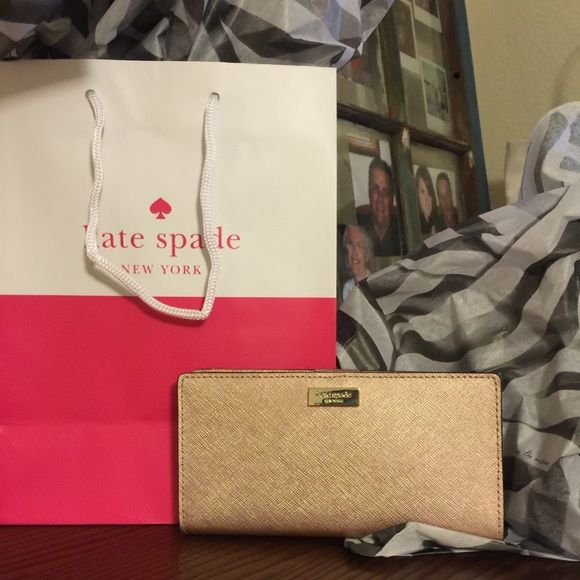 """Kate Spade wallet NWT!! NWT Kate Spade wallet in Newbury lane rosegold pink. This is a """"Stacy"""" style wallet. Retails for $110 what a great gift for someone you love or for yourself!!! Comes with Kate Spade gift bag and tissue paper for wrapping!! kate spade Bags Wallets"""