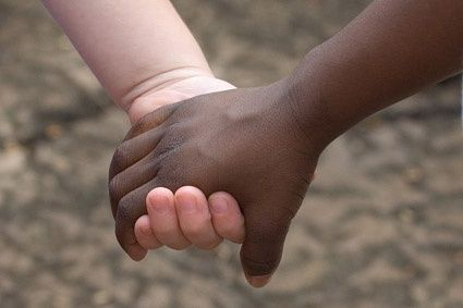 blacks and whites holding hands stock photo