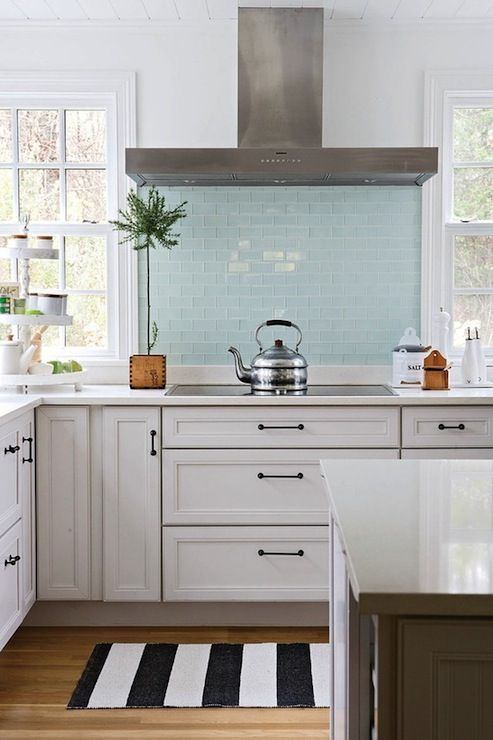 BHG: Gorgeous L shaped kitchen clean white walls and large windows flanking  powder blue glass