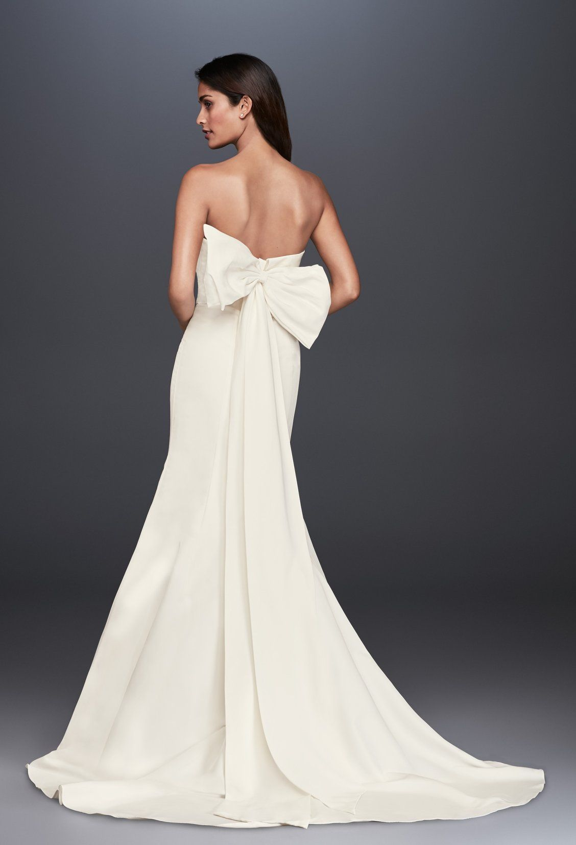 Looking for a modern wedding dress? This strapless mermaid wedding ...