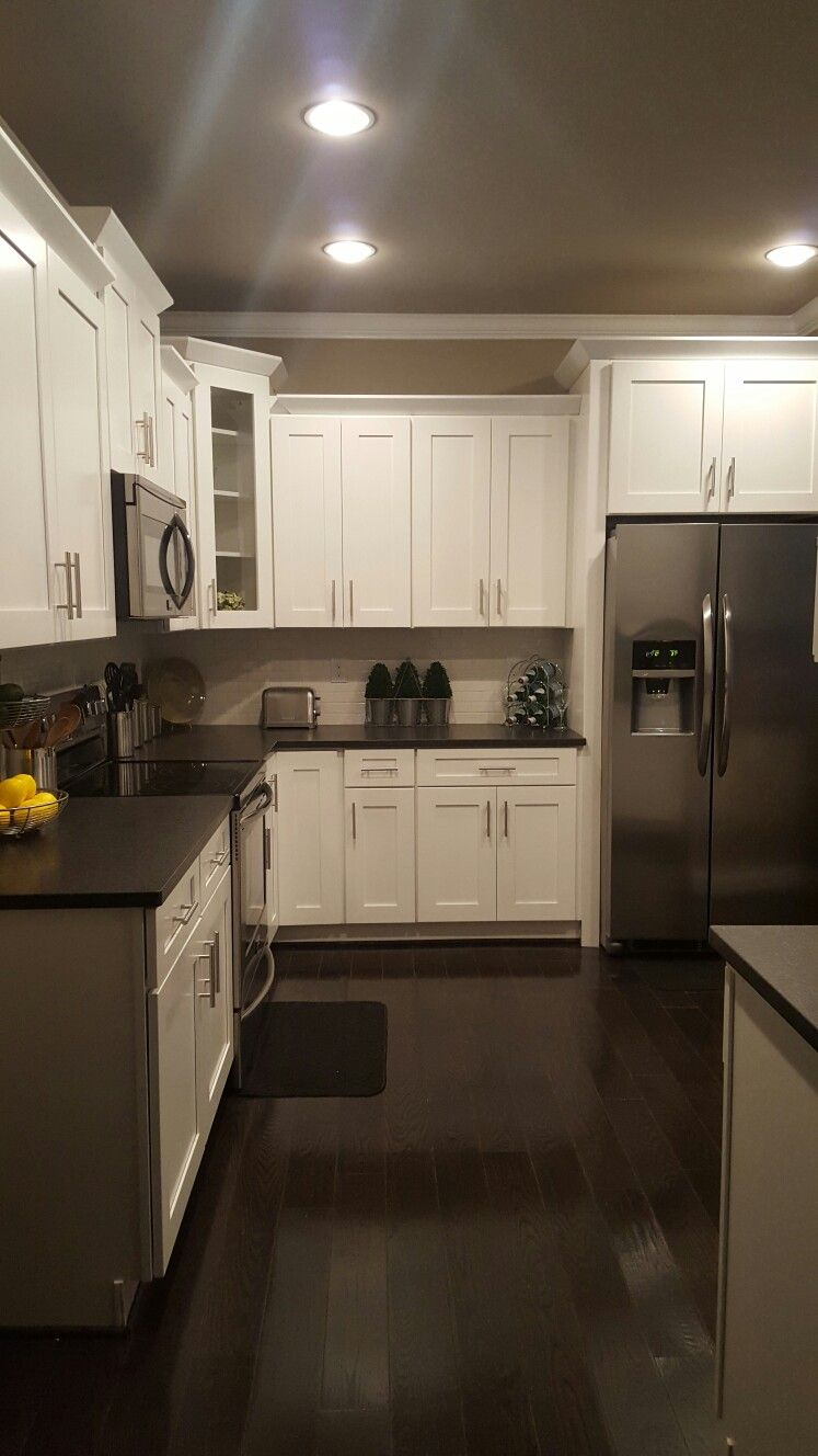 White Shaker Cabinets With Black Pearl Leathered Granite