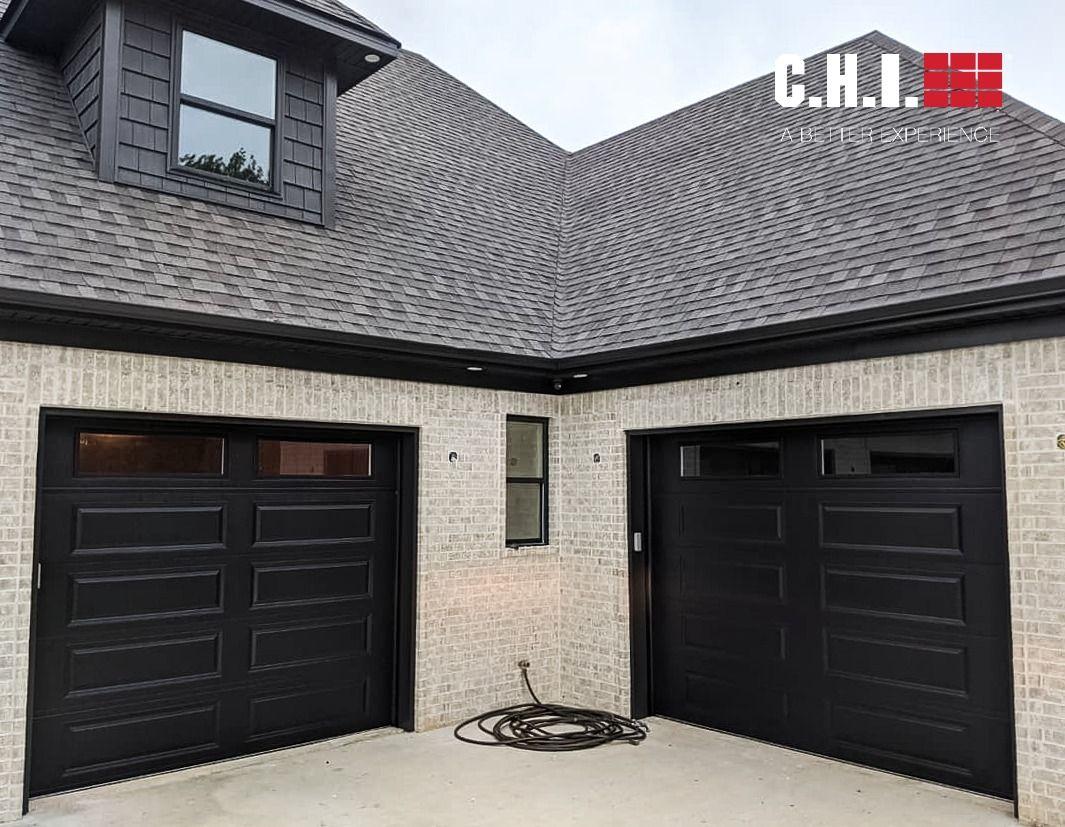 Black Raised Panel Garage Doors From The Timeless Collection In 2020 Overhead Door Garage Door Panels Raised Panel
