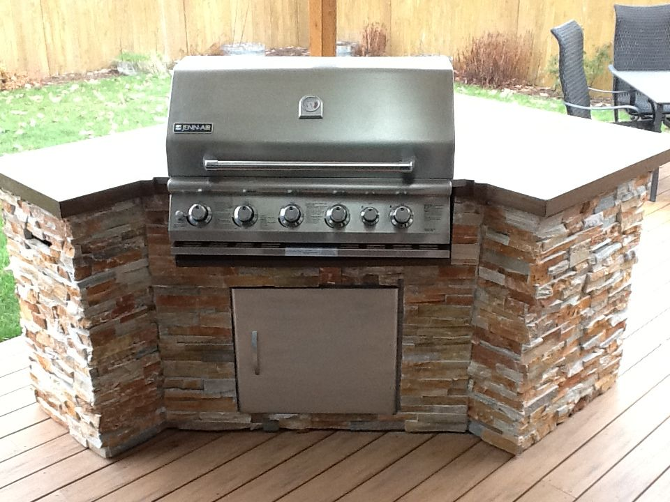 built in bbq with stacked stone tile and solid surface concrete countertop outdoor kitchen on outdoor kitchen bbq id=64920