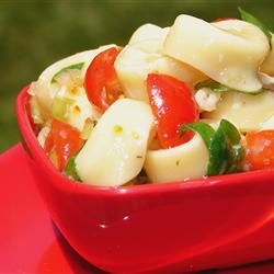 This salad is a snap to make and looks and tastes very Italian. Cheese tortellini are cooked al dente and tossed with spinach, Parmesan cheese, cherry tomatoes, sliced black olives, and a prepared Italian dressing. Great barbecue salad.