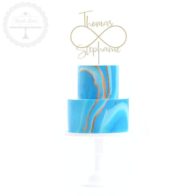 A vibrant blue marbled cake perfect for a seaside wedding.