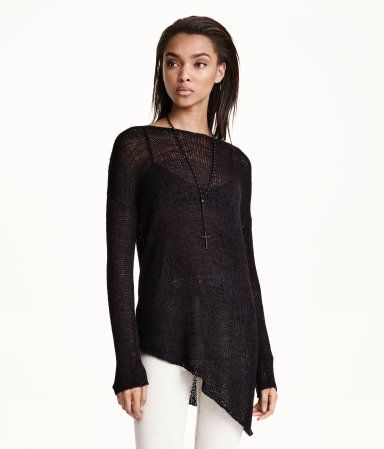 Loose-knit sweater with long sleeves and an asymmetric hem.