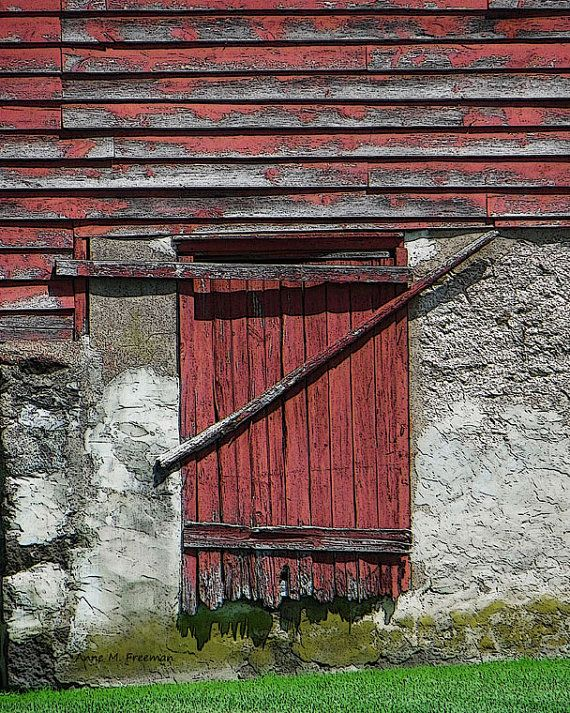 Photo Of An Old Red Barn Door Is Barred To Keep It Shut The