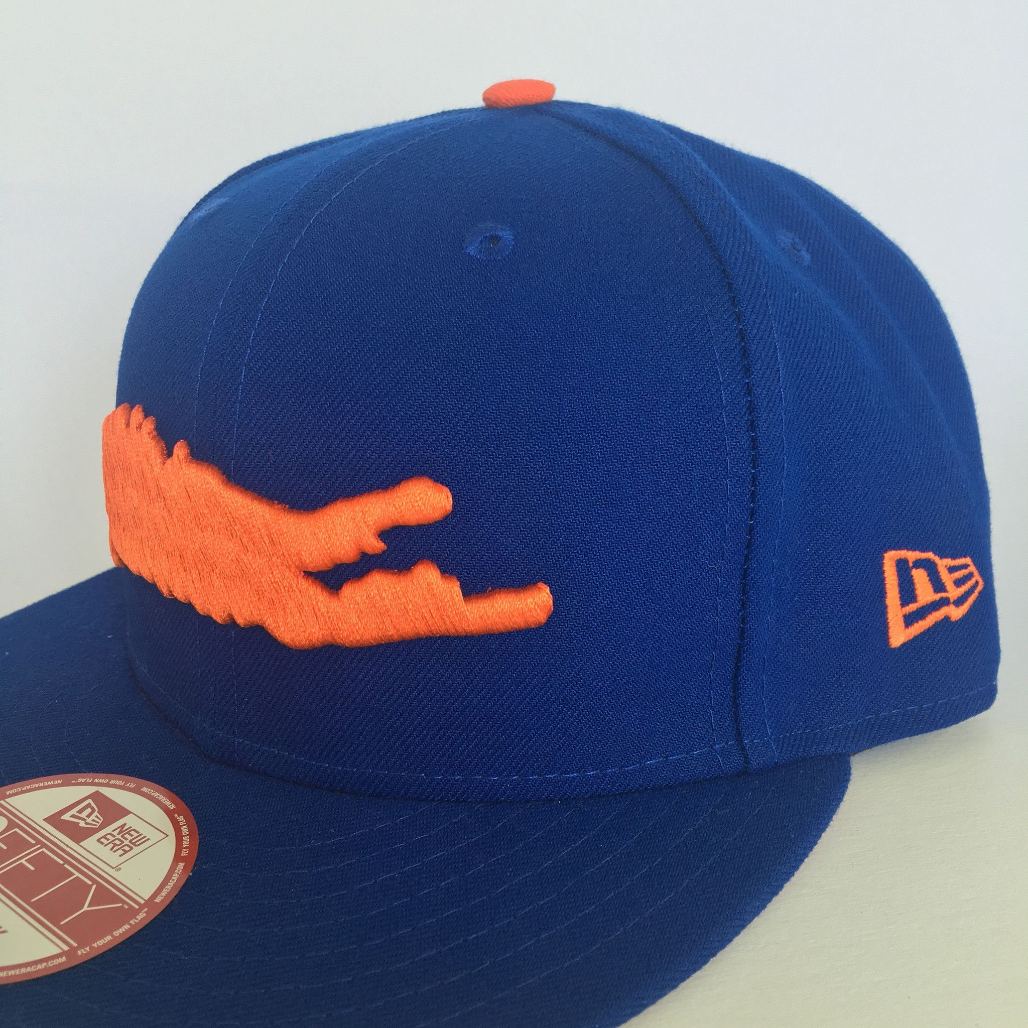 f532168276ac9c The Royal Blue and Orange Official Long Island New Era 9FIFTY snapback  features a pop out