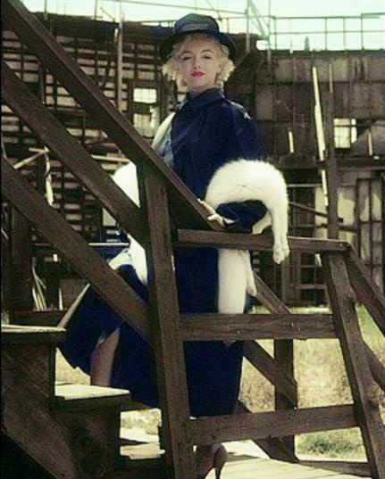 Marilyn. Black coat sitting. Photo by Milton Greene, 1956.