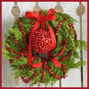 Dress up a plain cedar bough wreath with cranberries by OceanSpray.com