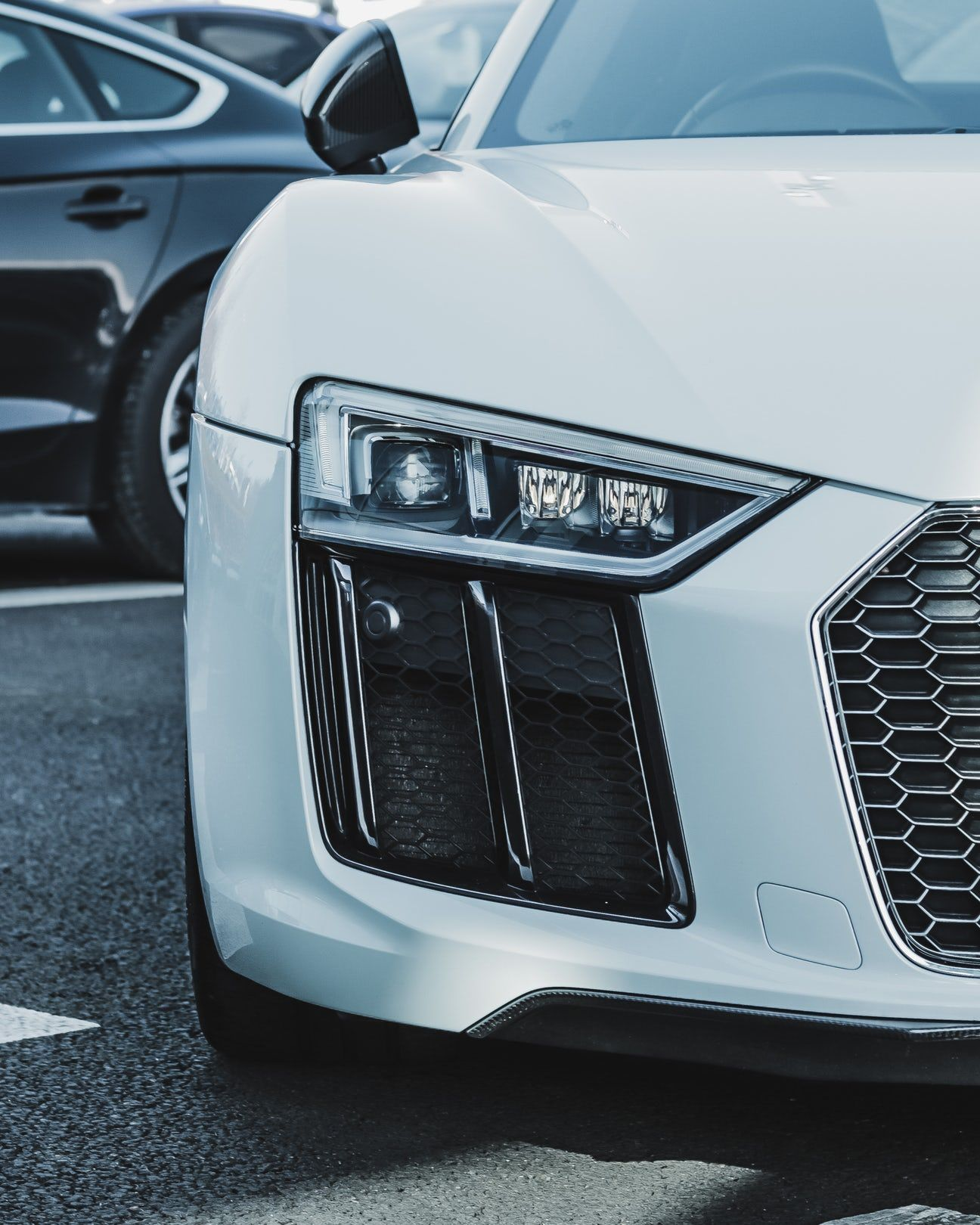 Close Up Photo Of White Car Car Audi Sports Car