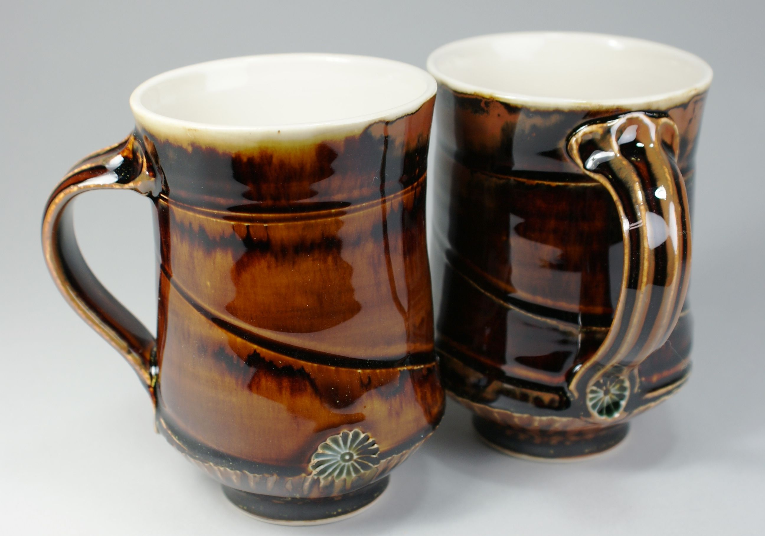 Cone 10 oxidation porcelain cups  Albany slip amber celadon