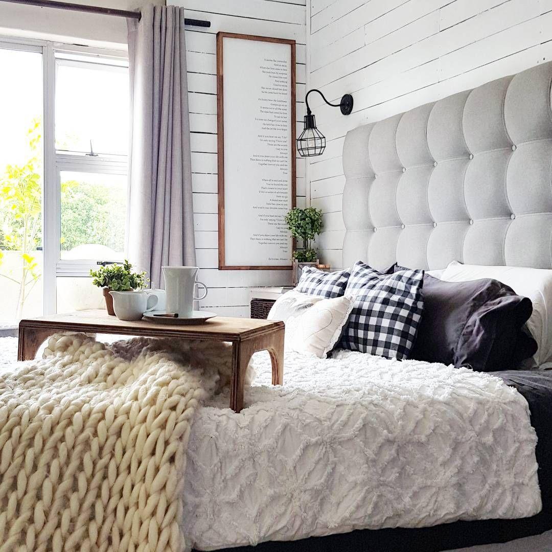 2 window bedroom ideas  shiplap bedroom with gray tufted headboard and big window