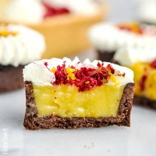 Yuzu White Chocolate Tart. Flavourful fragrant Yuzu White Chocolate Tart topped with freeze-dried raspberries and whipped coconut cream. #sweets #desserts #recipes #freezedriedraspberries
