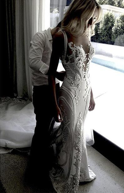 e2869066de97 Sexy Plunging Neckline Wedding Dress. Ornate  amp  couture wedding dresses  like this may ...