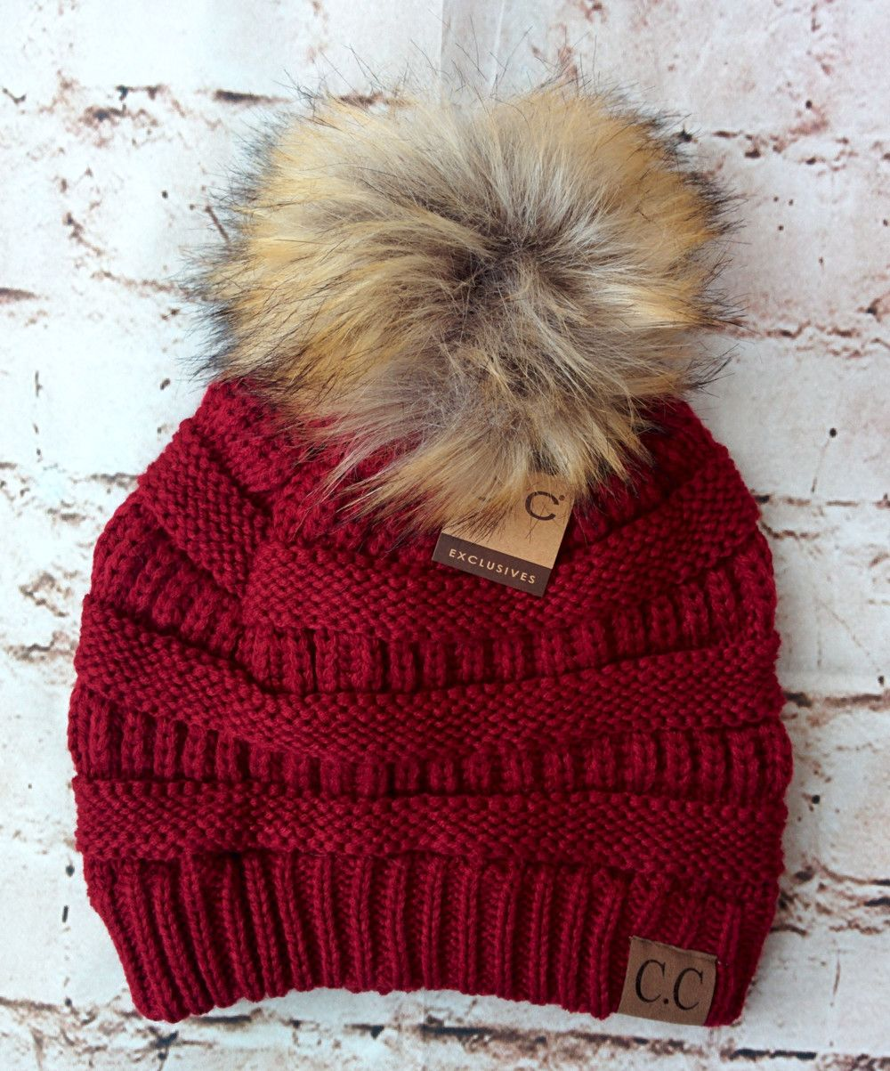 A little twist on the popular CC beanie hats - a faux fur pom pom on top!  Available in 20 fabulous colors - the perfect winter accessory! 39dbdb4457c