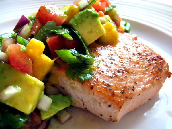 for SALSA:  1/2 a large avocado, peeled &diced,1/3 C peeled, diced mangos, 2 TBS minced red onions,2 TBS minced red bell peppers or tomatoes,1 TBS minced fresh cilantro  1 TBS  fresh lime juice  ½ tsp minced jalapeno peppers  ¼ teaspoon sea salt  FOR THE SALMON  ½ tsp EVOO  four 4-ounce salmon fillets  pinch sea salt  pinch freshly ground pepper