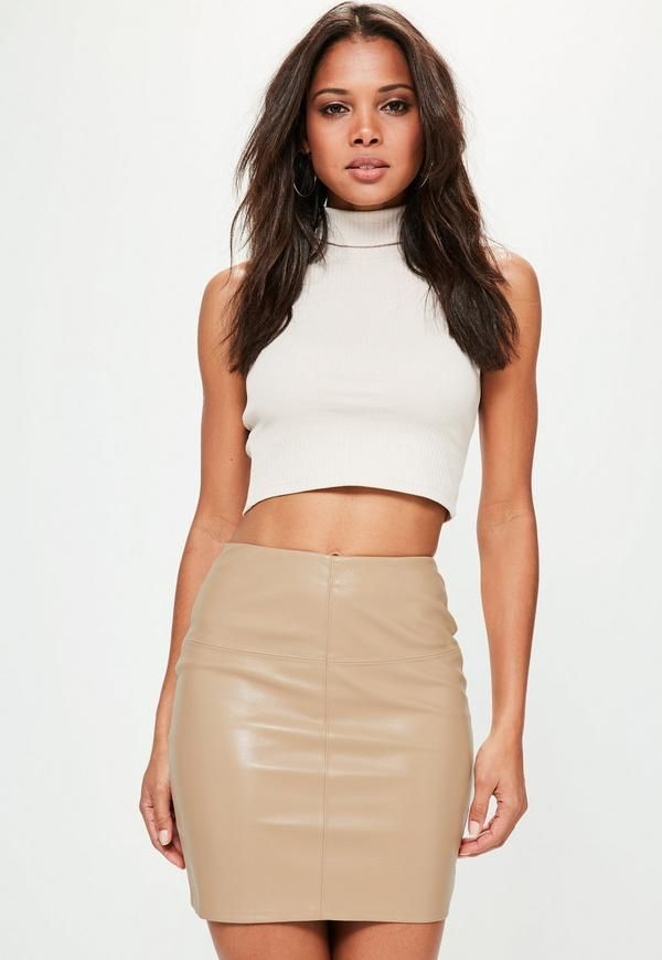 A faux leather skirt is a girl s best friend. Snap up this mini piece with  its killer black hue 423d69478