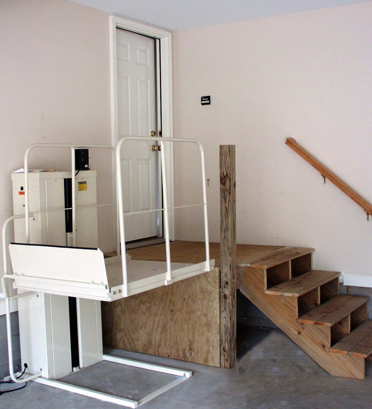 Wheelchair ramp in garage low cost solutions for making for Wheelchair accessible housing