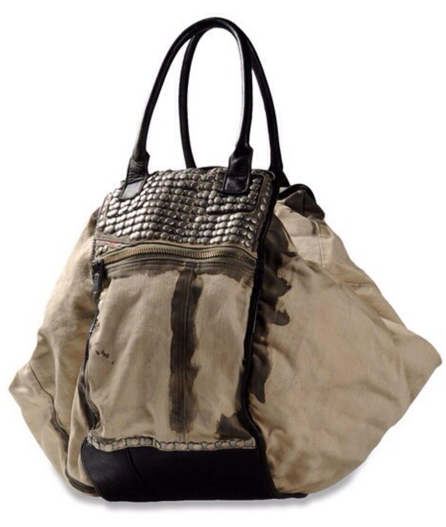 43e37e531f01 Canvas and leather oversized bag.