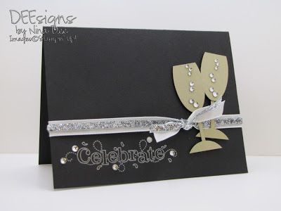 black cardstock is a classy background for this handmade new years card silver ink on the sentiment matches the bling of the rhinestones and ribbon