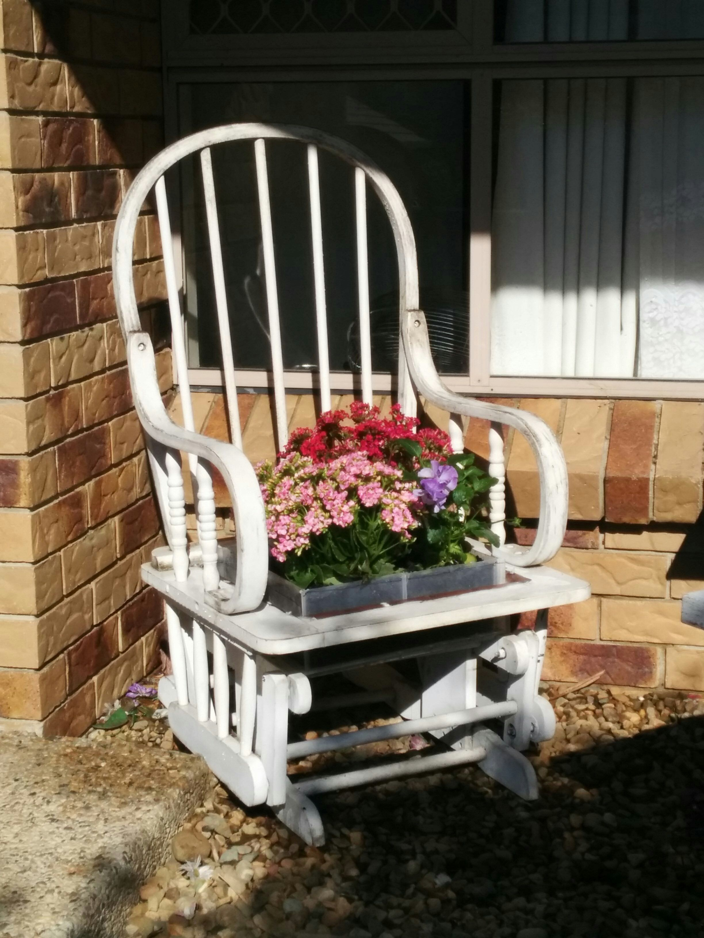 With this old rocking chair I cut the seat out first Bolted the