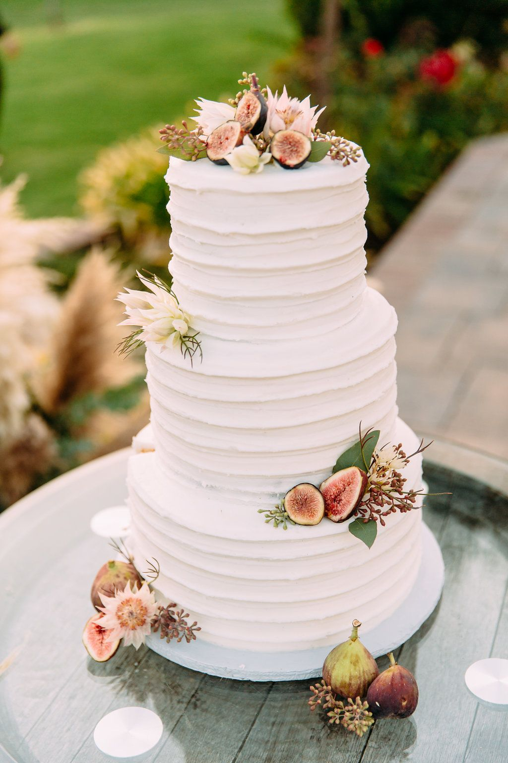 Fig and blushing bride wedding cake florals mount palomar winery