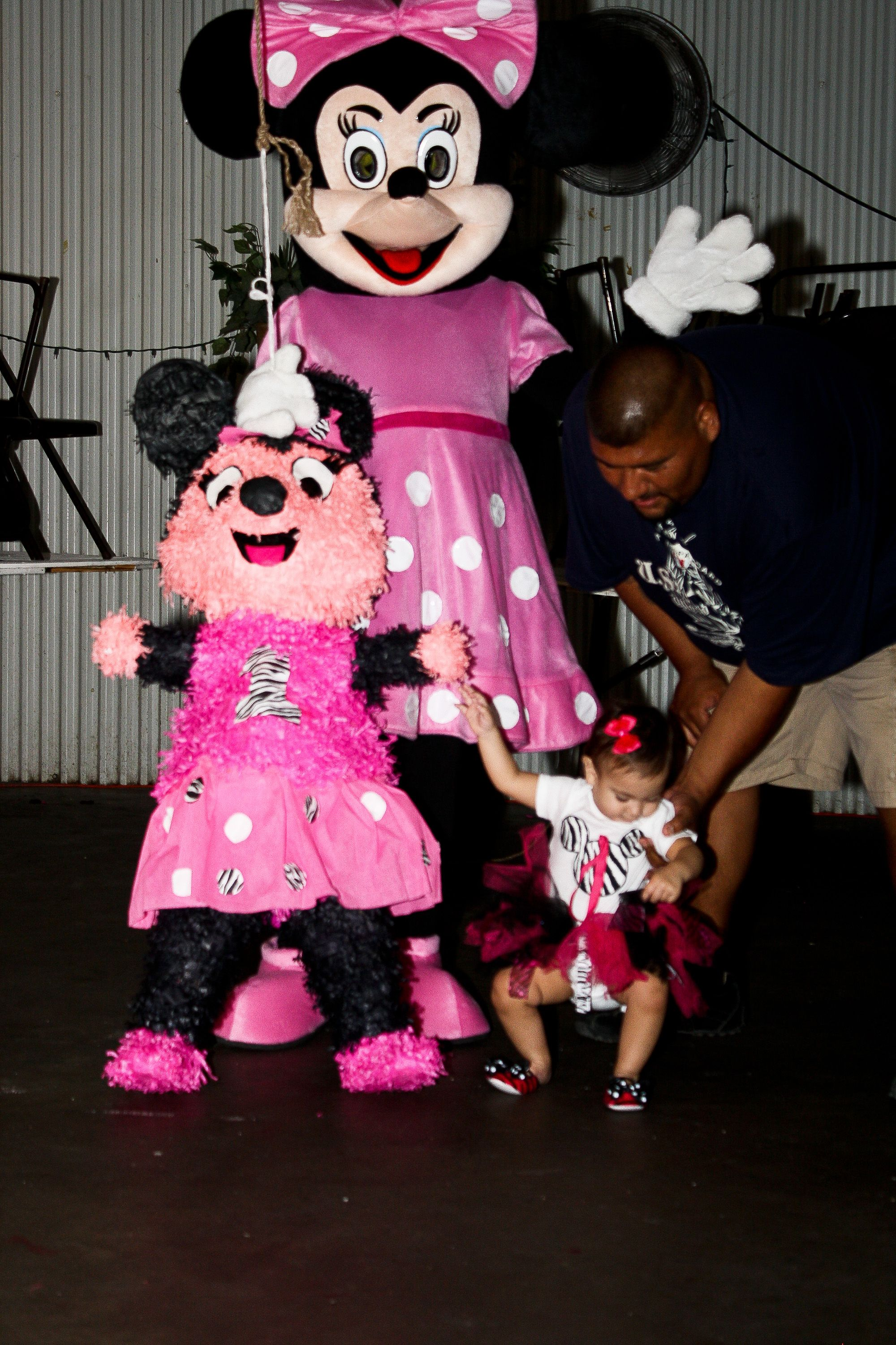 Minnie mouse with bday baby and minnie mouse pinata.