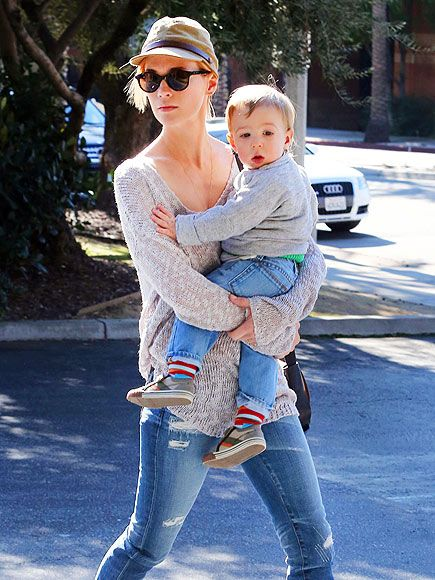 It looks like January Jones is back to being a blonde! She was spotted in Pasedena sporting her usual sunnies, with son Xander in her arms, of course!