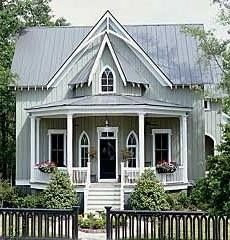 Love exterior. Victorian Carpenter Gothic design with a  metal  roof  and  vertical  board and batten wood siding.