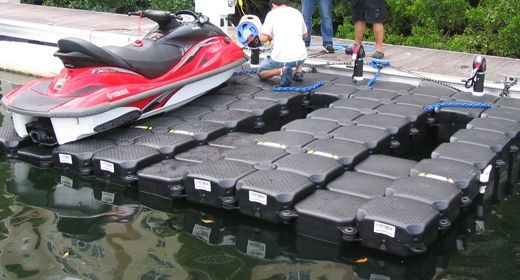 Use a jet ski floating dock to protect your pwc from the for Boat garage on water