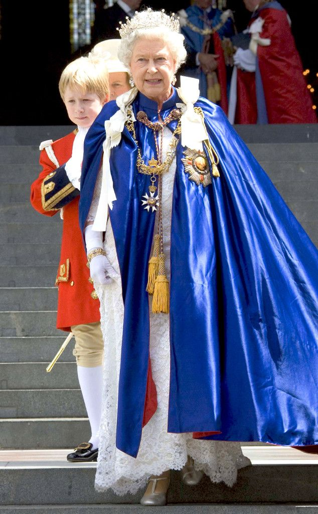 2008 Queen Elizabeth II donned a royal blue cape and white-lace gown at the Order of St Michael and St George service in London.