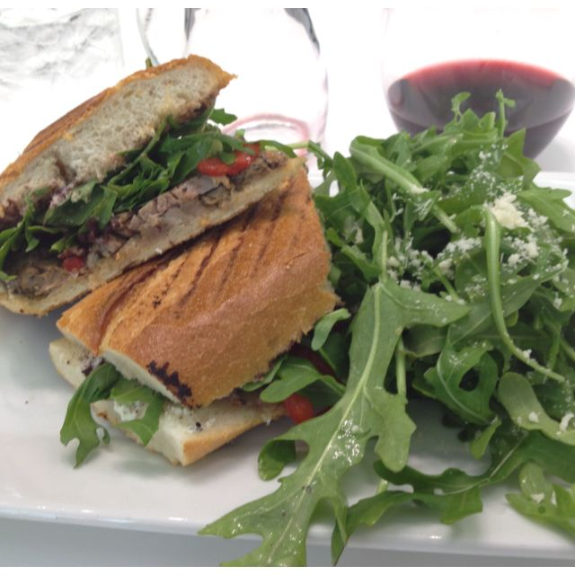 Merchant: Duck Confit Croque Baton, goat cheese, arugula, tapenade, roasted piquillo. Morellino di Scansano