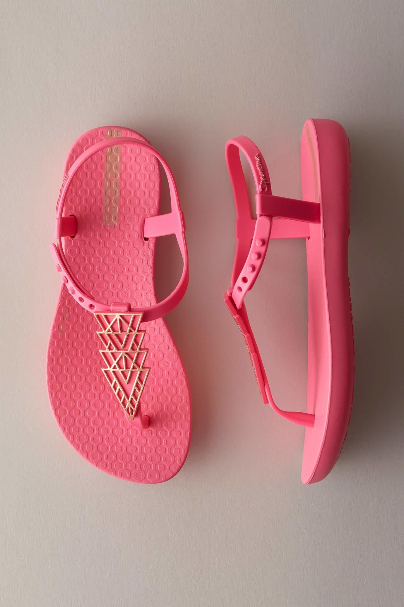 943b38fc741919 Summer feet will love these lightweight pink sandals with a metallic  art-deco design. Comfortable