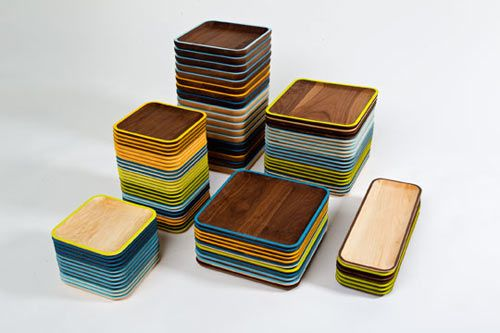 The Koldebord Collection is functional set of tabletop serving pieces reminiscent of Danish modern design. Each plate is formed from a solid piece of wood and features a nice scooped center with a fun colorful edge detail.