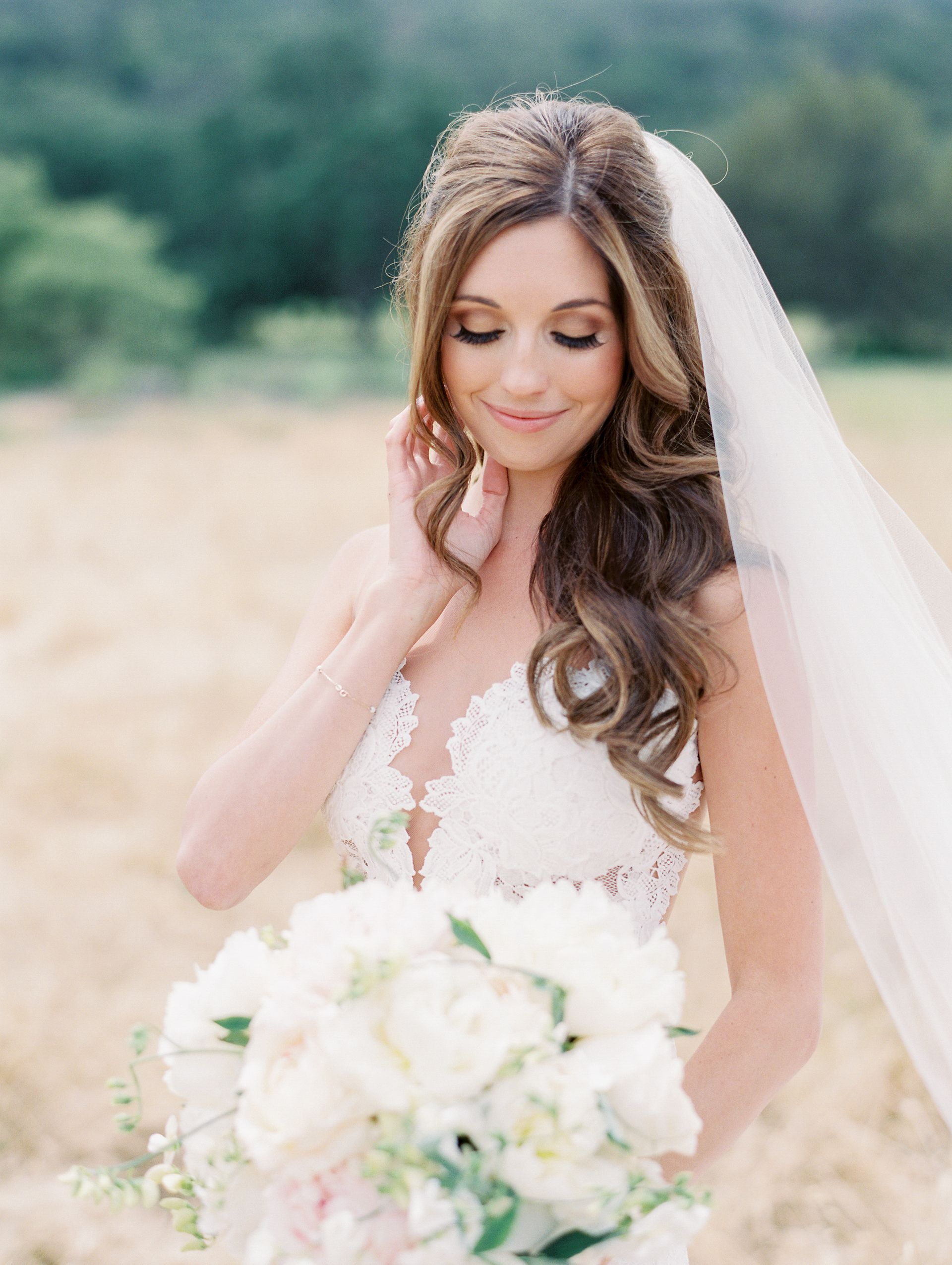 Teased half updo, romantic bridal curls, classic veil