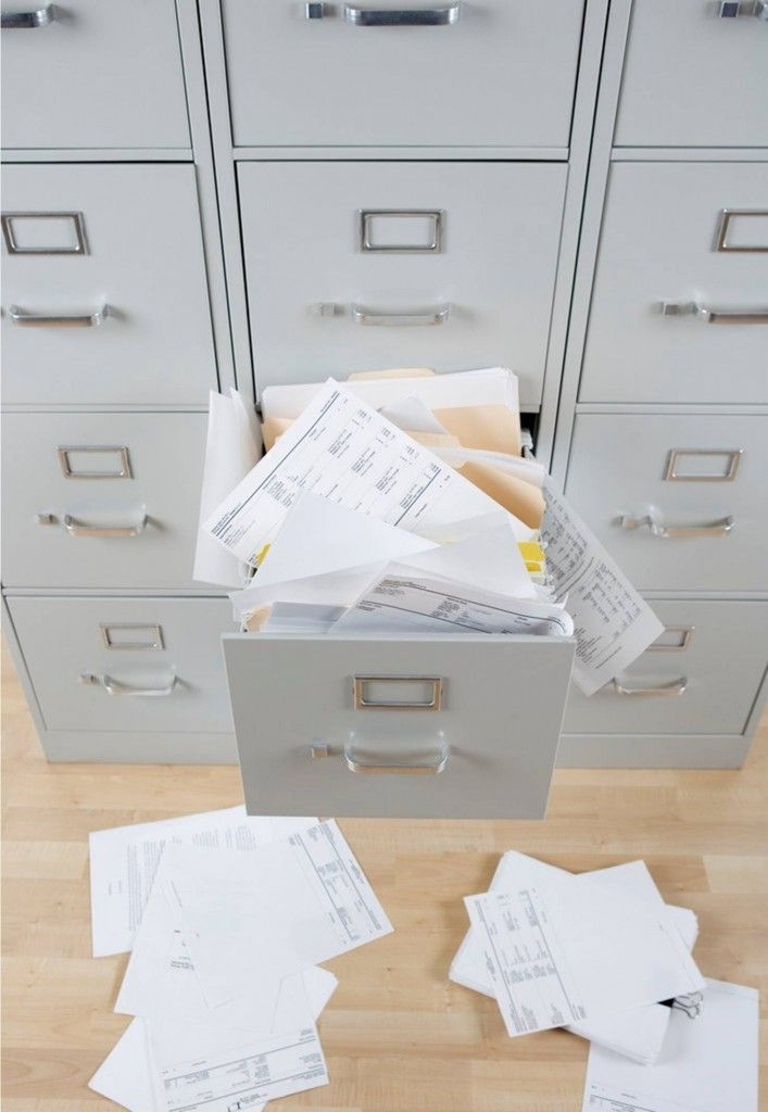 messy file cabinet. overflowing filing cabinet messy file a