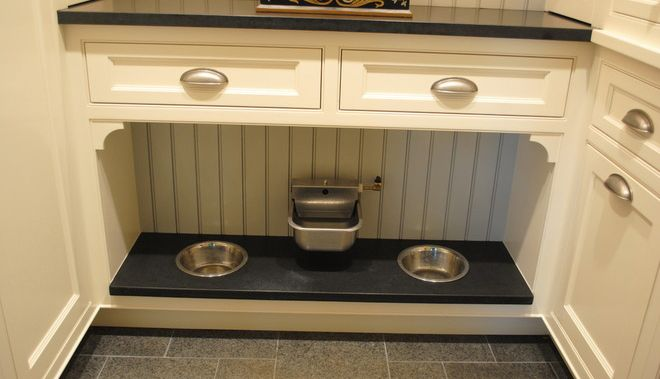 Pet Feeding Station With Water Fountain Built Into A Cabinet