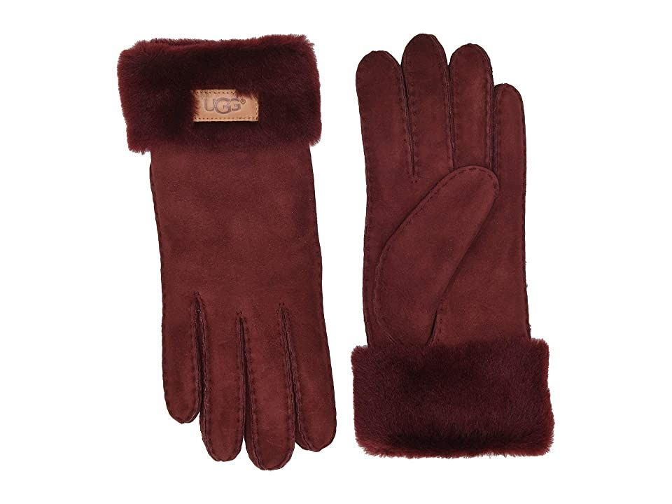 UGG Turn Cuff Water Resistant Sheepskin Gloves (Port) Extreme Cold Weather Gloves. Embrace your wintry morning in these sleek UGG Turn Cuff Water Resistant Sheepskin Gloves. Water-resistant gloves made from sheepskin leather. Plush shearling cuff with signature leather patch. Shell: 100% sheepskin leather. Cuff: real fur  dyed  shearling from sheep originated from Spain. Spot clean by leather specialist. Imported. #UGG #Accessories #Gloves #ExtremeColdWeather #Burgundy